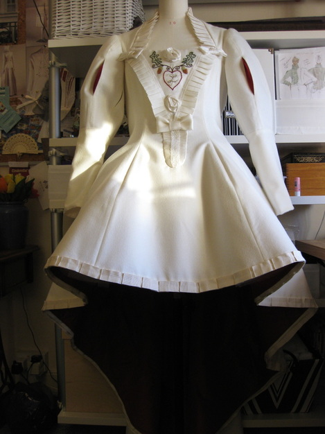 Atelier Redolent dress: view showing hemline shape - short at front, long at the back
