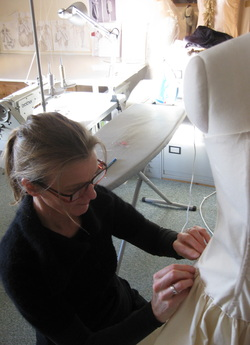 Bobbie Seagroatt working on a dress
